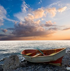 oared boat on a sea coast