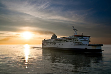 Ferry boat on the sunset in the sea
