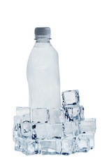Ice cubes and mineral water bottle isolated over white