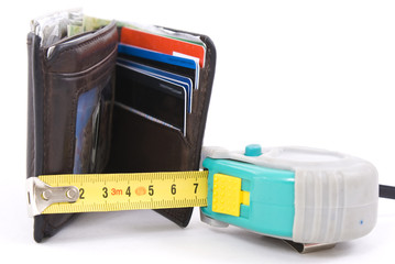 Brown wallet and yellow tape measure