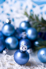 Blue glass Christmas balls on blue  background