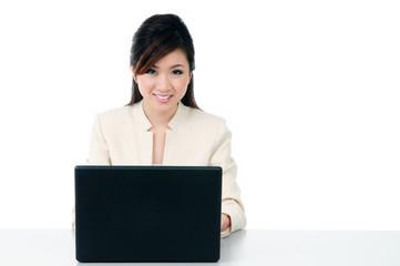 Happy businesswoman using laptop