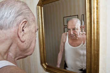 elder pensive at the mirror