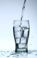 Cold purified water in the glass with bubbles