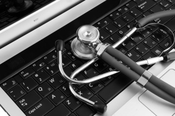 Stethoscope and laptop close up