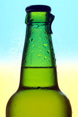 Beer bottle on a yellow-blue background
