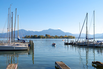 Sailing boats parking in the Chiemsee lake pier, Germany