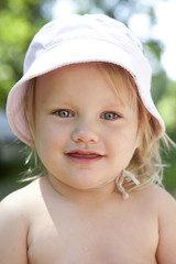 portrait of little blond girl with blue eyes wearing Panama