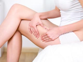 Woman folding skin on her hips