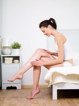 Caring about woman's leg with cream