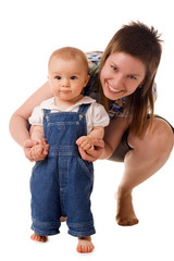 Small child in jeans with mom