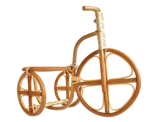 Wooden bicycle. Made by human hands from the dry wood.