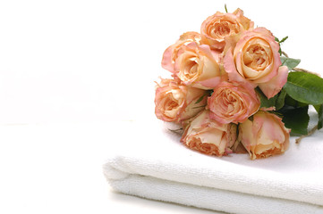 Bouquet of roses over towel