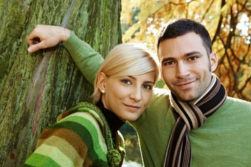Closeup outdoors portrait of young couple
