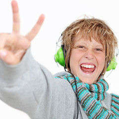 child doing v sign for success wearing headphones