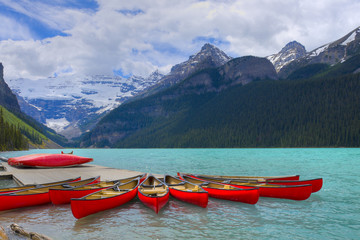 Foto op Canvas Canada HDR Canoes on Lake Louise, Banff Canada