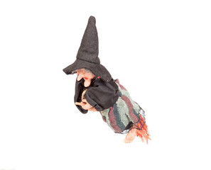 Old Halloween witch with broomstick and hat