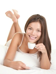 Woman in bed drinking coffee