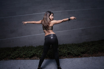 Woman posing with arms outstretched