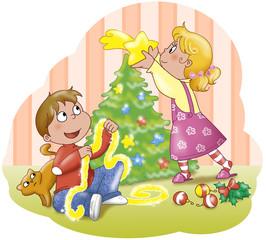Bambini addobbano l'albero di Natale