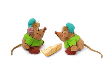 Two rats near a piece of a cheese