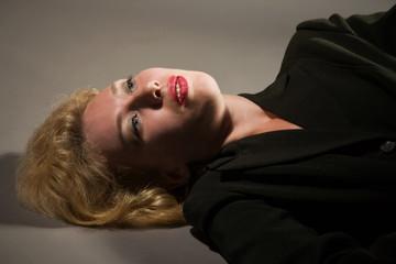 Lifeless pretty woman lays on the floor