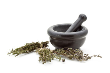 Dried herbs in mortar