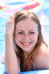 portrait of a beautiful happy woman in swimming pool