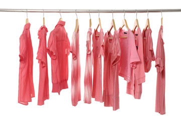 Rows of red t shirts on a clothesline.