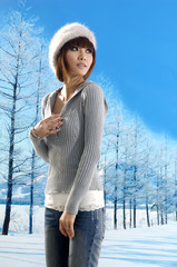 Asian beautiful asian model posing in winter snowy park.