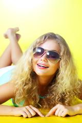 Beautiful girl on a yellow background