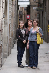 Three women poses at the street