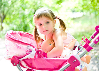 little girl with doll and carriage