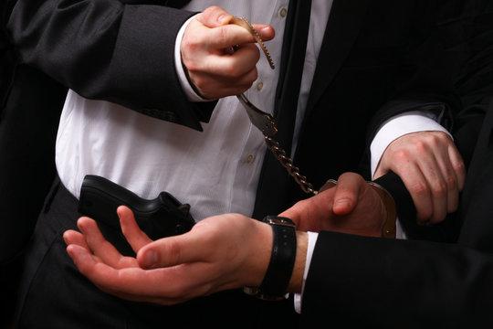 business man being handcuffed
