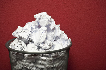 trash can filled with rumpled paper