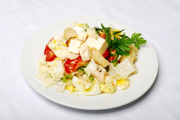 Vegetable Salad With Cheese On The White Table