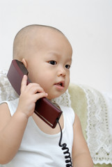 baby with telephone