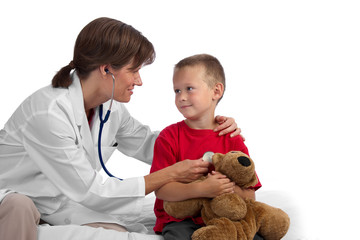 Female caucasian doctor giving a boy a physical