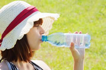 girl drinking water outdoor