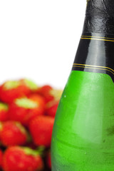 Champagne glass and strawberries isolated on white