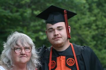 Proud grandma and grandson at graduation