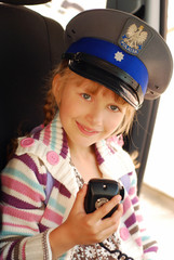 young girl in police hat