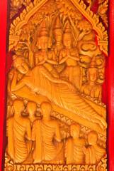 gold buddha statue on wood
