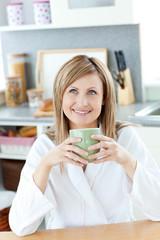Smiling woman drinking something