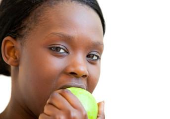 Sweet woman eating apple