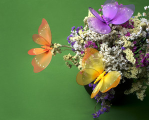 decorative colourful butterflies on flowers