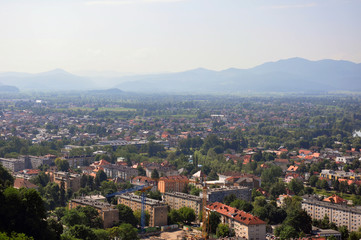 View over Ljubljana and foggy mountain horizon