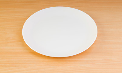 Empty plate on the wooden table