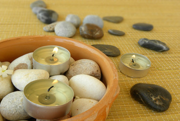 Spa. Massage stones, candles and jasmine