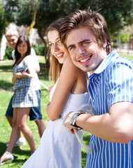 young  couples playing tug of war game and having fun